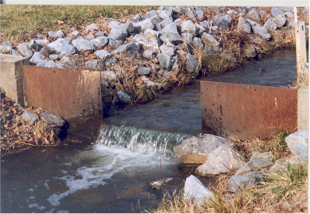 A stream of water passing through gates for water monitoring